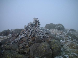 Stone Carin at the summit of Hard Knot.